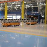 AGVs que trabajan en tándem para mover trenes y vagones :: DTA