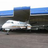 Puerta apilable de doble lona para hangares :: CHAMPIONDOOR